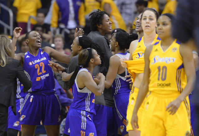 Phoenix Mercury's Charde Houston, left, celebrates with teammates as Los Angeles Sparks' Jenna O'Hea, second from right, and Lindsey Harding look on after the Mercury defeated the Sparks in Game 3 of a WNBA basketball Western Conference semifinal series, Monday, Sept. 23, 2013, in Los Angeles. The Mercury won 78-77. (AP Photo/Mark J. Terrill)