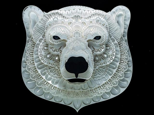 <p>Intricate paper cut out of a polar bear. (Photo: Patrick Cabral/Caters News </p>
