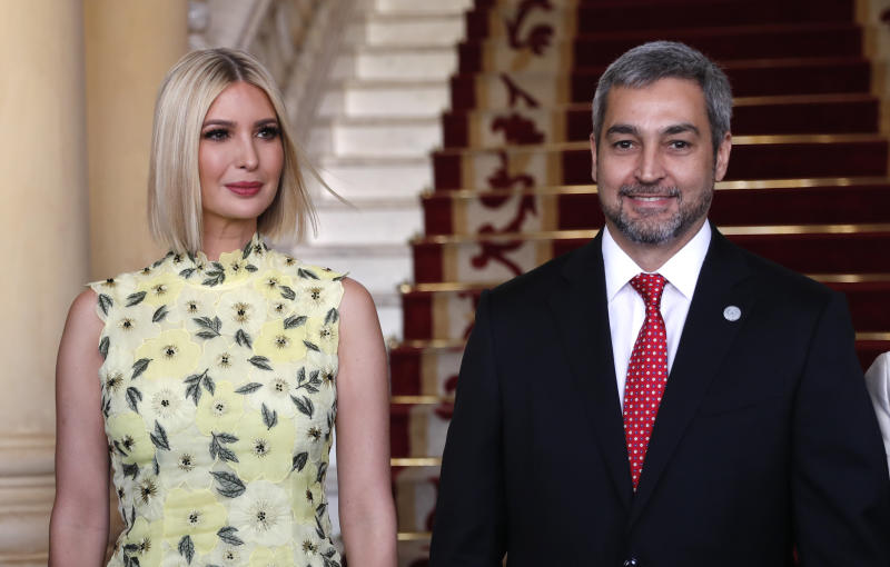 Ivanka Trump, President Donald Trump's daughter and White House adviser, and Paraguay's President Mario Abdo Benitez, pose for photos at Presidential Palace in Asuncion, Paraguay, Friday, Sept. 6, 2019. Ivanka Trump is on her third stop of a South American trip to promote women's empowerment. (AP Photo/Jorge Saenz)