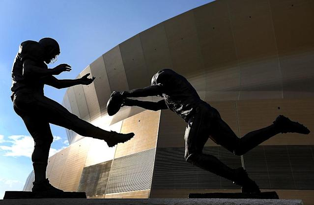 A statue outside the Superdome commemorates Steve Gleason's miracle punt block. (Getty)