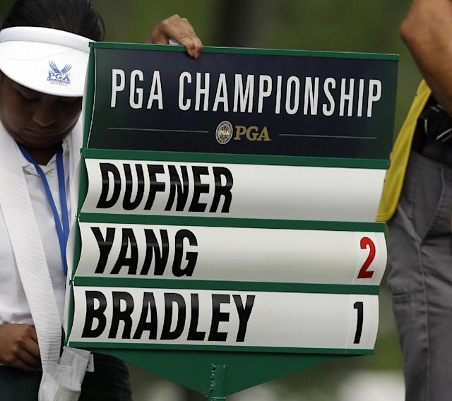 Jason Dufner's scorch is taken off the scoreboard after he withdraw after playing 10 holes during the first round of the PGA Championship golf tournament at Valhalla Golf Club on Thursday, Aug. 7, 2014, in Louisville, Ky. (AP Photo/John Locher)