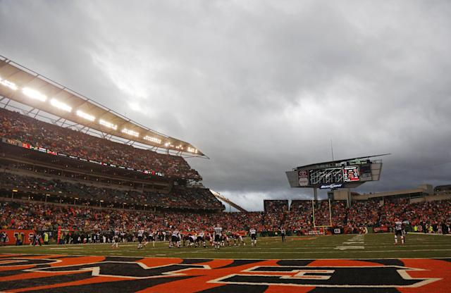 The Cincinnati Bengals play the Cleveland Browns in the second half of an NFL football game, Sunday, Nov. 17, 2013, as storms move into Cincinnati. (AP Photo/David Kohl)