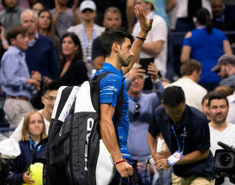US Open: Novak Djokovic retires against Stan Wawrinka as title defence ends