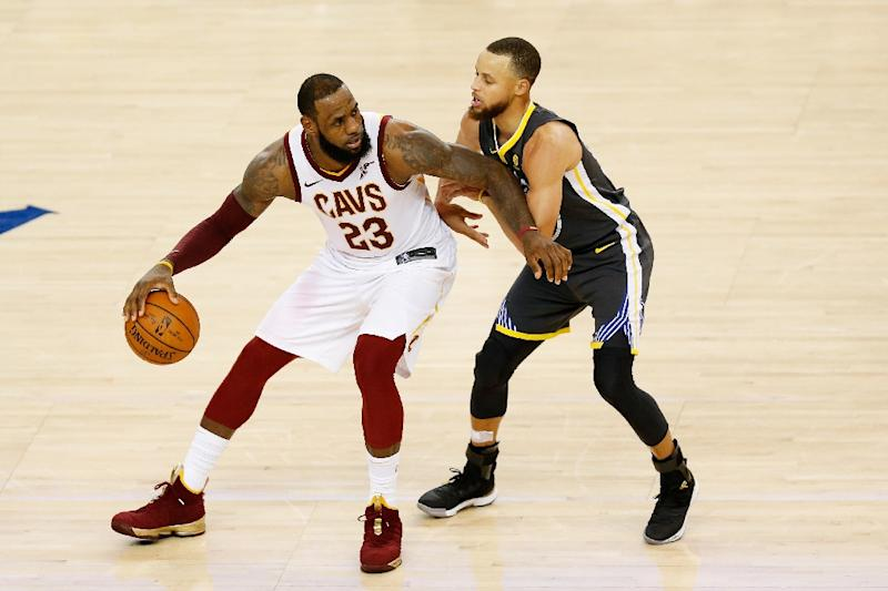 307df805c4fed LeBron James of the Cleveland Cavaliers drives against Stephen Curry of the  Golden State Warriors in