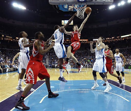 Houston Rockets point guard Goran Dragic (3) drives to the basket against New Orleans Hornets small forward Al-Farouq Aminu (0) in the first half of an NBA basketball game in New Orleans, Thursday, April 19, 2012. (AP Photo/Gerald Herbert)