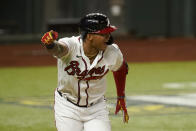 Atlanta Braves' Cristian Pache celebrates his RBI-single against the Los Angeles Dodgers during the sixth inning in Game 4 of a baseball National League Championship Series Thursday, Oct. 15, 2020, in Arlington, Texas. (AP Photo/Eric Gay)