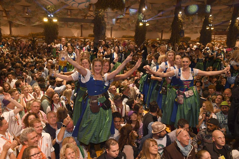 07 October 2018, Bavaria, Munich: Servants dance on the tables in the Hofbräuzelt at the Oktoberfest on the last day of the Wiesn at the Kehraus. The biggest folk festival in the world lasted from 22.09. to 07.10.2018. Photo: Felix Hörhager/dpa (Photo by Felix Hörhager/picture alliance via Getty Images)