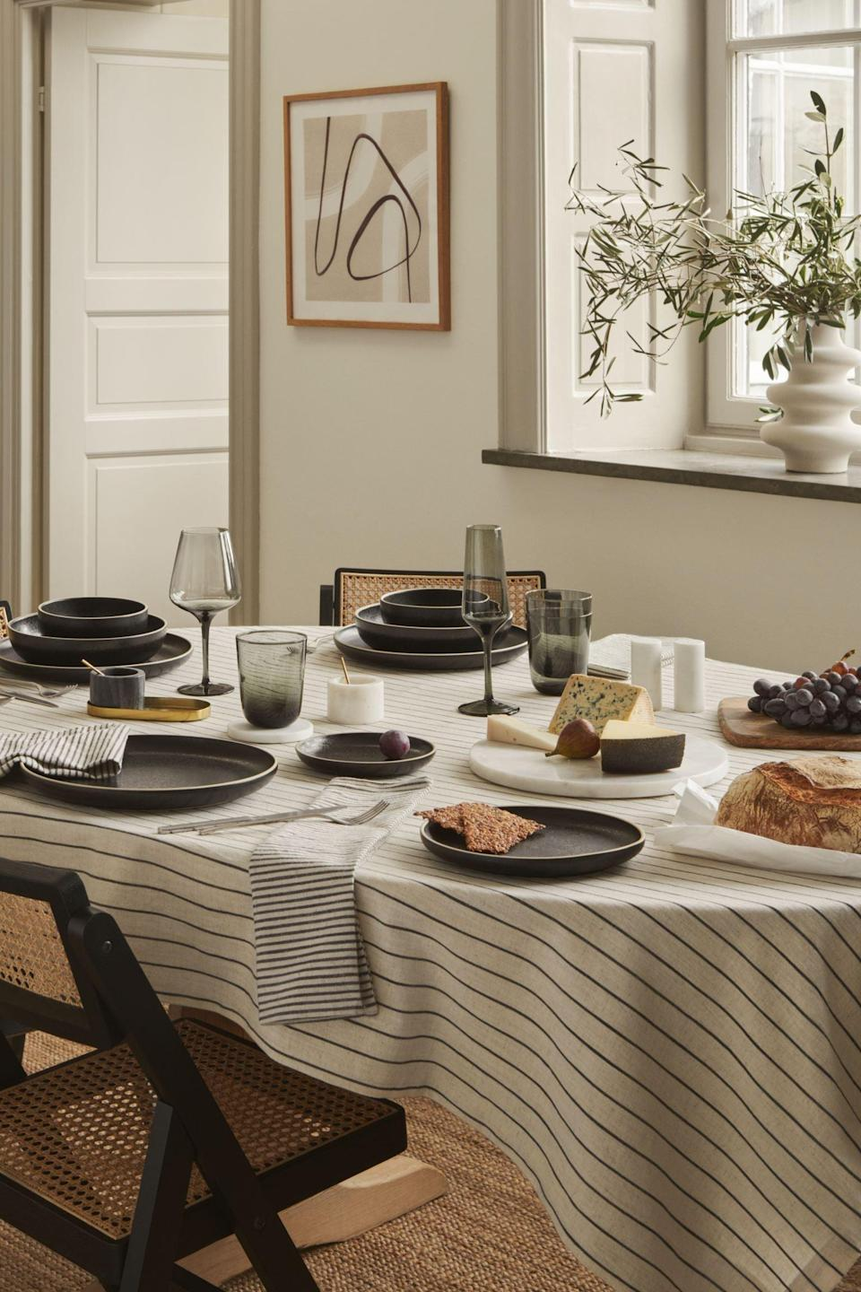 <p>This <span>Striped Linen-blend Tablecloth</span> ($25) will elevate your dinner table help maintain a light and welcoming atmosphere. The striped pattern is just the cherry on top of the cake.</p>