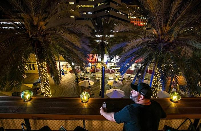 Chef and restaurant owner Jorgie Ramos, a partner at Cebada, looks out over Giralda Plaza as he anticipates the upcoming opening of his rooftop restaurant in Coral Gables.