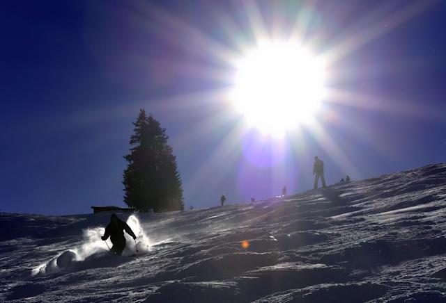 Skiers and snowboarders on the slopes near Diablerets (AFP Photo/Fabrice Coffrini)