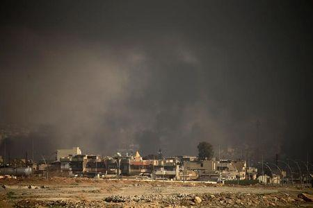 Smoke rises from clashes during a battle between Iraqi forces and Islamic State militants in Mosul