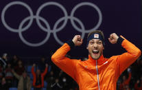 <p>Gold medallist Kjeld Nuis of The Netherlands celebrates on the podium after the men's 1,500 meters speedskating race at the Gangneung Oval at the 2018 Winter Olympics in Gangneung, South Korea, Tuesday, Feb. 13, 2018. (AP Photo/John Locher) </p>