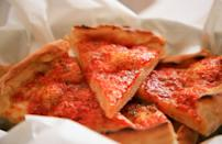 "<p>If you're from New Jersey, you know pizza isn't the same as tomato pie. Also known as Trenton tomato pie because of its city of origin, this dish has the base of a crisp thin-crust pizza except for the tomato sauce, which is made from seasoned, crushed plum tomatoes and goes on top of the cheese. You can find the iconic Jersey staple at some of the <a href=""https://www.thedailymeal.com/101-best-pizzas-america-2019/slide-51?referrer=yahoo&category=beauty_food&include_utm=1&utm_medium=referral&utm_source=yahoo&utm_campaign=feed"" rel=""nofollow noopener"" target=""_blank"" data-ylk=""slk:best pizza shops in America"" class=""link rapid-noclick-resp"">best pizza shops in America</a>.</p>"