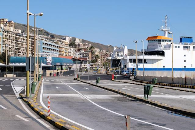 A deserted car boarding area is pictured at the ferry terminal in Messina, Sicily, on March 10, 2020. (Credit: Giovanni Isolino/AFP)