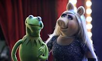 <p><strong>For Miss Piggy:</strong> A flashy dress with sequins, a string of pearls, a blond wig, and a pig nose and ears.</p> <p><strong>For Kermit:</strong> Wear a green collar with a frog mask or paint your face green.</p>