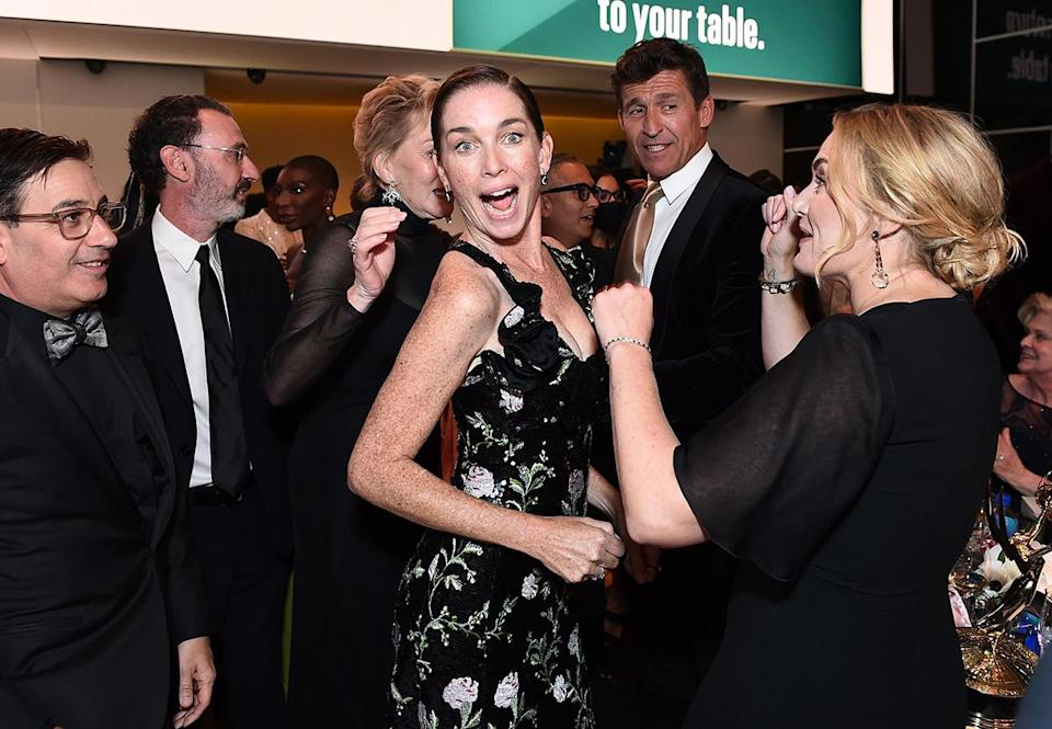 <p>Wahoo! Nicholson looked elated, with Winslet by her side. </p>
