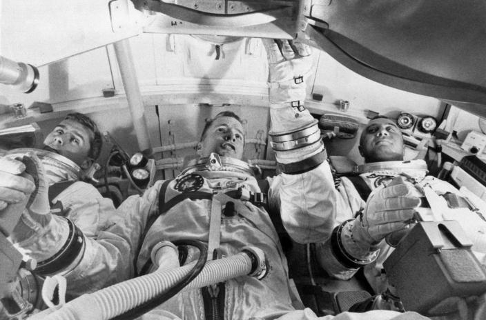FILE - In this undated photo made available by NASA, from left, astronauts Roger Chaffee, Edward White II, and Virgil Grissom, practice for their launch test in the Apollo Mission Simulator at Cape Kennedy, Fla. During a launch pad test on Jan. 27, 1967, a flash fire erupted inside their capsule killing the three Apollo crew members. (NASA via AP)