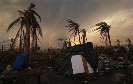 Part of a rainbow appears over the makeshift home of a family in Guiuan