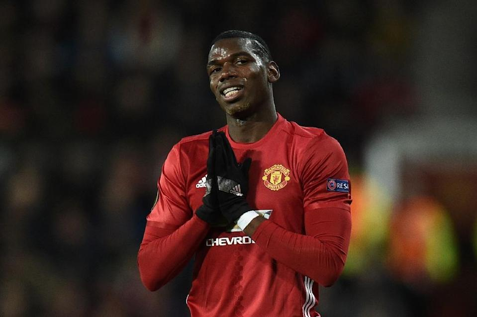 Paul Pogba's £89.3 million transfer from Juventus to Manchester United in August 2016 has come under particular scrutiny amid reports the player's agent will earn some £41 million from the deal (AFP Photo/Oli SCARFF )