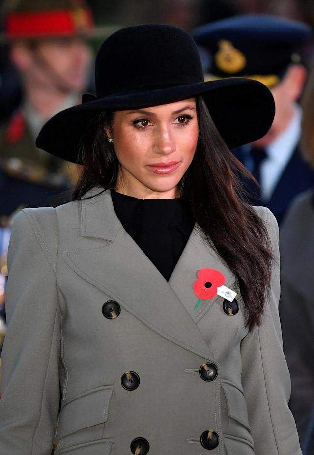 Markle paid her respects with somber style and a poppy pin. (Photo: Toby Melville/AFP/Getty Images)