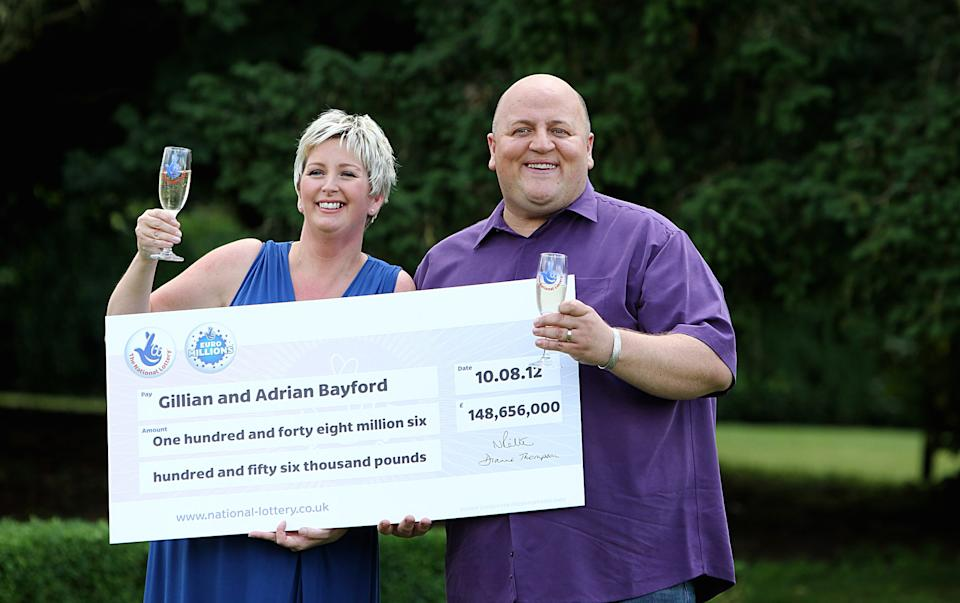 Adrian Bayford, 41, and wife Gillian, 40, from Haverhill, Suffolk, after a press conference at Down Hall Country House Hotel in Hatfield Heath, Hertfordshire, after they won £148.6 million on Friday's EuroMillions jackpot.   (Photo by Sean Dempsey/PA Images via Getty Images)
