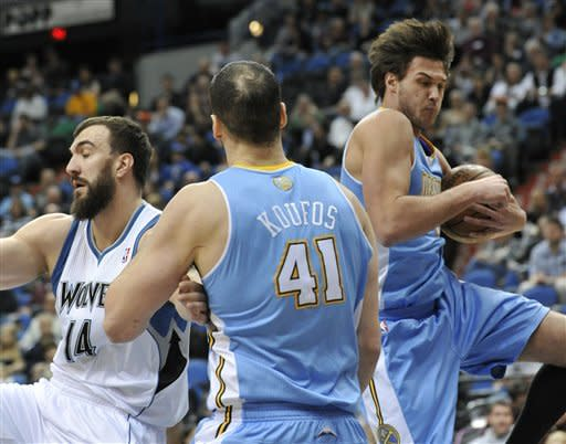 Denver Nuggets' Danilo Gallinari, right, of Italy, pulls in a defensive rebound, beating Minnesota Timberwolves' Nikola Pekovic, left, of Montenegro, to the ball as Kosta Koufos (41) helps defend Pekovic during the first half of an NBA basketball game Thursday, April 26, 2012, in Minneapolis. (AP Photo/Jim Mone)