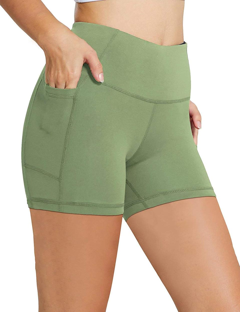 """<h3>Baleaf High-Waist Compression Shorts With Side Pockets </h3><br><br>Looking for even tinier, top-rated pair of leggings with deep pockets? Look no further than this #1 Best Seller compression short from Amazon that boasts close to 2,000 reviews and 4.3 out of 5 stars.<br><br>The customer hype says it all: """"The pocket fit my iPhone 7 in its case and held it firmly against my upper outer thigh so there wasn't bouncing around and I didn't get chaffed. There was also a hidden pocket at the waist that could actually hold a key with fob, not just a single key. Again, HOORAY and why don't more makers of activewear think of this? How many people just run out the door with NOTHING when they go run, walk or bike? I am 5'6"""" and wear a size 8 comfortably and the medium fit the way I wanted. It felt supportive and snug but nothing was tight. I am a runner and appreciate that the legs of the shorts didn't ride up as I ran. Fabric was a good thickness, not at all see through. I am a fan!""""<br><br><strong>Baleaf</strong> 5"""" High Waist Compression Shorts With Side Pockets, $, available at <a href=""""https://www.amazon.com/BALEAF-Workout-Control-Running-Pockets/dp/B07TXP4DF9/ref=sr_1_59_sspa"""" rel=""""nofollow noopener"""" target=""""_blank"""" data-ylk=""""slk:Amazon"""" class=""""link rapid-noclick-resp"""">Amazon</a>"""