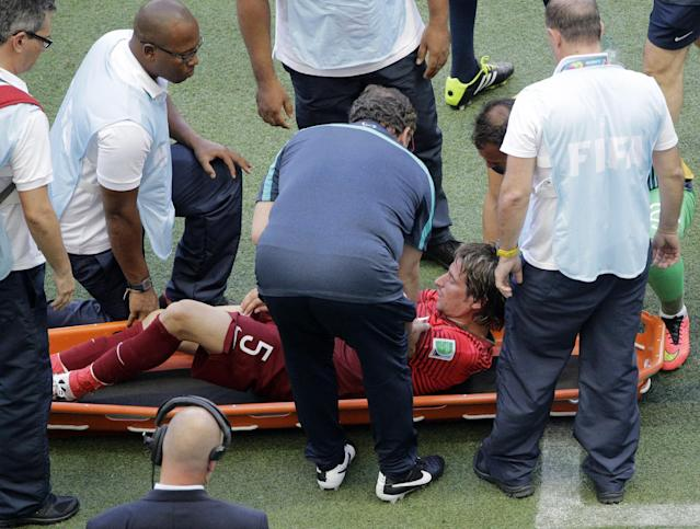 Portugal's Fabio Coentrao is taken away on a stretcher after being injured during the group G World Cup soccer match between Germany and Portugal at the Arena Fonte Nova in Salvador, Brazil, Monday, June 16, 2014. (AP Photo/Christophe Ena)