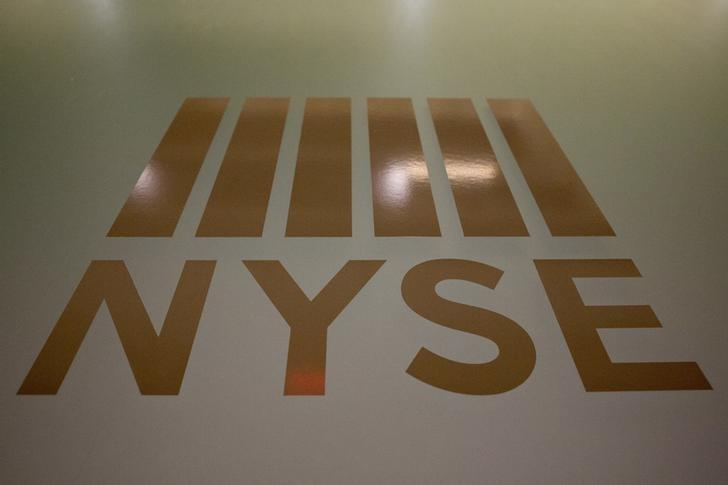 A New York Stock Exchange logo is displayed on the floor of the New York Stock Exchange