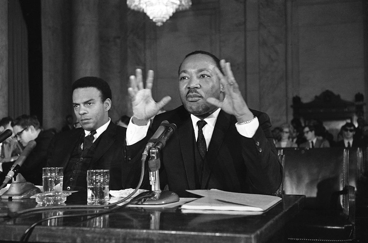 "King, alongside the Rev. Andrew Young, executive vice president of the Southern Christian Leadership Conference, speaking on March 2, 1968, says the ""poor people's campaign"" is demanding action by Congress to provide jobs for the poor. (Photo: AP)"