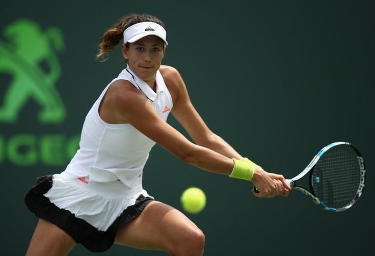 Garbine Muguruza of Spain had to pull out the stops again to deal with China's Zhang Shuai 4-6, 6-2, 6-2 in just over two hours at the Miami Open