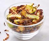 """<p>An air fryer can turn a highly healthy vegetable into a crunchy treat everyone will love.</p><p><a href=""""https://www.delish.com/cooking/recipe-ideas/a19673558/best-brussels-sprout-chips-recipe/"""" rel=""""nofollow noopener"""" target=""""_blank"""" data-ylk=""""slk:Get the recipe from Delish »"""" class=""""link rapid-noclick-resp""""><em>Get the recipe from Delish »</em></a></p>"""