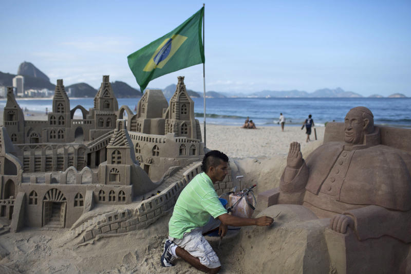 Artist Rogean Rodrigues builds a sand sculpture of Pope Francis in preparation for the pontiff's visit for World Youth Day events along Copacabana beach in Rio de Janeiro, Brazil, Tuesday, July 16, 2013. Pope Francis will travel to Brazil and participate in World Youth Day events from July 22-28. (AP Photo/Felipe Dana)