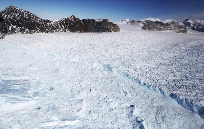 <p>A glacier is seen from NASA's Operation IceBridge research aircraft, in the Antarctic Peninsula region, on Oct. 31, 2017, above Antarctica. (Photo: Mario Tama/Getty Images) </p>