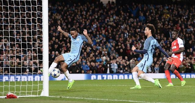 Manchester City's midfielder Raheem Sterling (L) jumps out of the way as Manchester City's midfielder Leroy Sane (2R) taps in their fifth goal during the Champions League football match against Monaco February 21, 2017 (AFP Photo/Oli SCARFF )