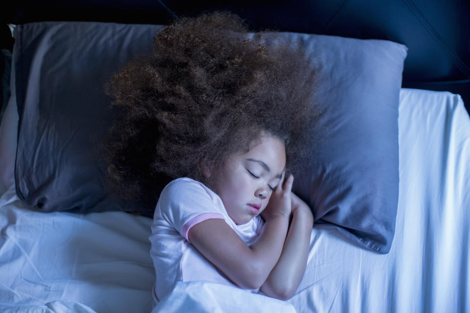 Want to see your kid like this every night? A year into the disrupting pandemic, it's time to get serious about a bedtime routine, say pediatric sleep experts. (Photo: Getty Images)