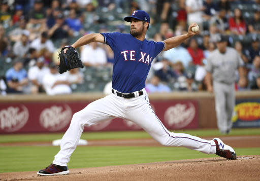 Texas Rangers starting pitcher Cole Hamels works against the New York Yankees during the first inning of a baseball game Tuesday, May 22, 2018, in Arlington, Texas. (AP Photo/Jeffrey McWhorter)