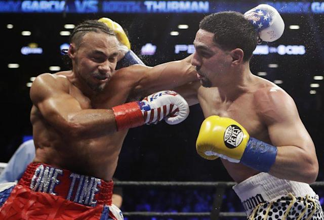 Keith Thurman (L) and Danny Garcia battle in their welterweight title fight Saturday, which peaked at 5.1 million viewers in the 12th round. (The Associated Press)