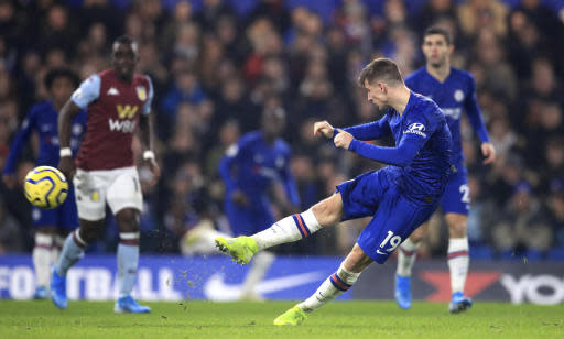 Chelsea's Mason Mount scores his side's second goal of the game against Aston Villa during their English Premier League soccer match at Stamford Bridge in London, Wednesday Dec. 4, 2019. (Adam Davy/PA via AP)