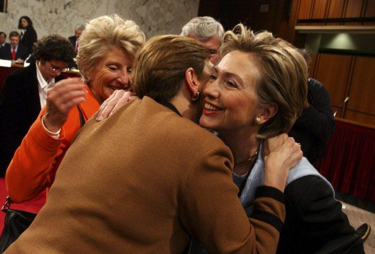 Sen. Hillary Clinton hugs Gorelick, a commission member, during a hearing of the 9/11 Commission. Rep. Jane Harman, D-Calif., is at left. (Photo: Tom Williams/Roll Call/Getty Images)