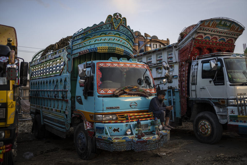 A truck driver checks his phone at a parking lot in Kabul, Afghanistan, Wednesday, Sept. 22, 2021. (AP Photo/Bernat Armangue)