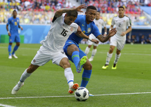 Costa Rica's Cristian Gamboa, left, and Brazil's Gabriel Jesus battle for the ball during the group E match between Brazil and Costa Rica at the 2018 soccer World Cup in the St. Petersburg Stadium in St. Petersburg, Russia, Friday, June 22, 2018. (AP Photo/Alastair Grant)