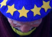 An anti-Brexit demonstrator wearing a beret with the EU flag design on it protests outside of the Houses of Parliament in London