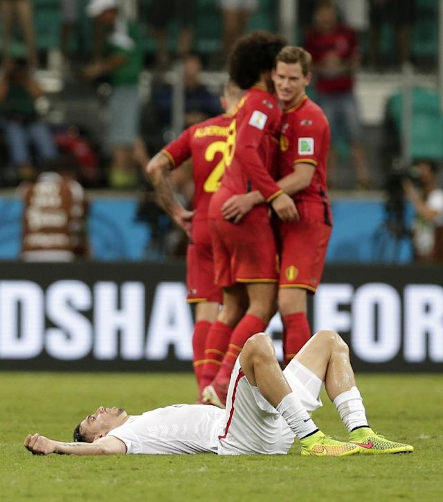 United States' Geoff Cameron lies on the pitch after Belgium defeated the USA 2-1 in extra time to advance to the quarterfinals during the World Cup round of 16 soccer match between Belgium and the USA at the Arena Fonte Nova in Salvador, Brazil, Tuesday, July 1, 2014. (AP Photo/Marcio Jose Sanchez)