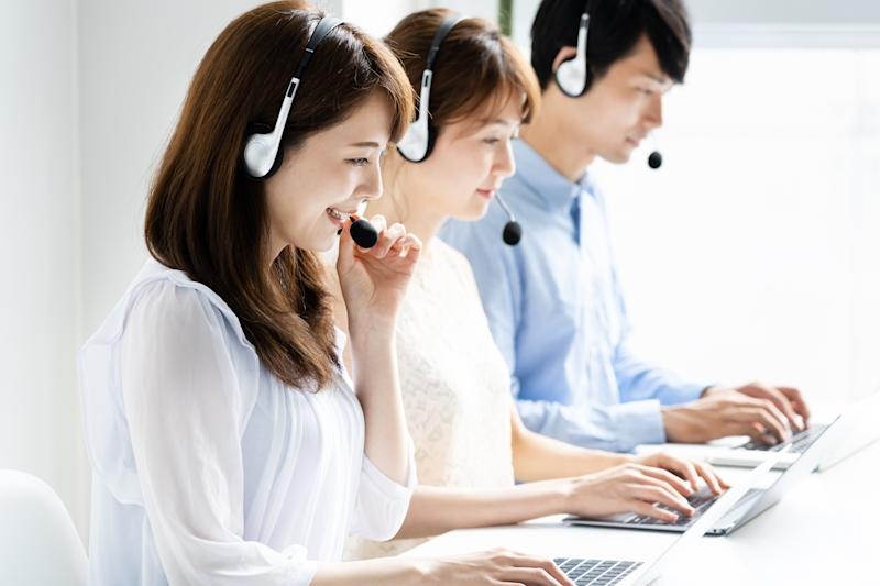young asian operator working in office