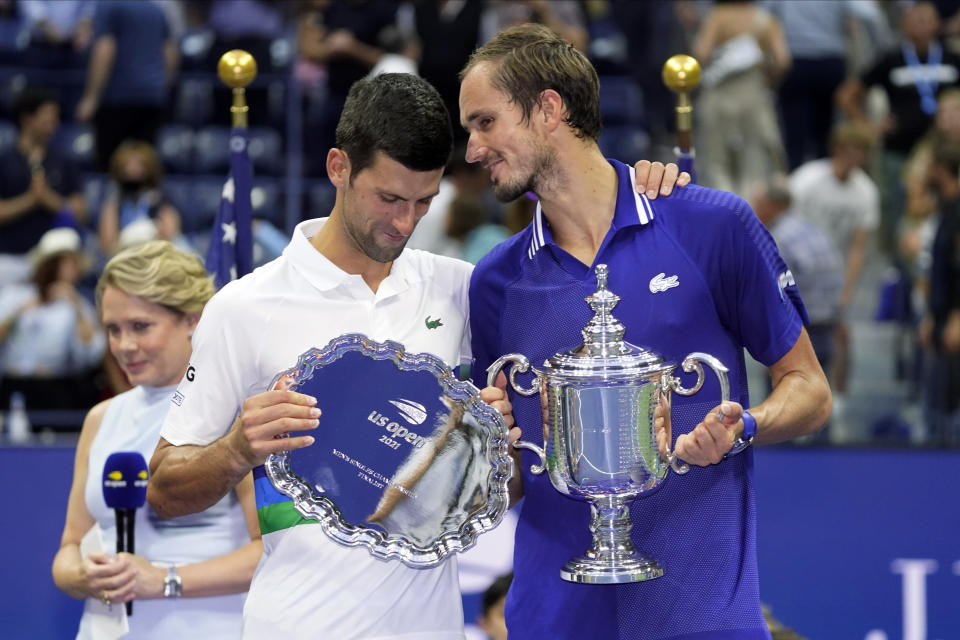 Daniil Medvedev, of Russia, right, talks with Novak Djokovic, of Serbia, after defeating Djokovic in the men's singles final of the US Open tennis championships, Sunday, Sept. 12, 2021, in New York. (AP Photo/John Minchillo)