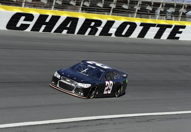 Austin Dillon drives his car out of Turn 4 during NASCAR Sprint Cup testing for the 2014 season at Charlotte Motor Speedway in Concord, N.C., Wednesday, Dec. 11, 2013. (AP Photo/Chuck Burton)