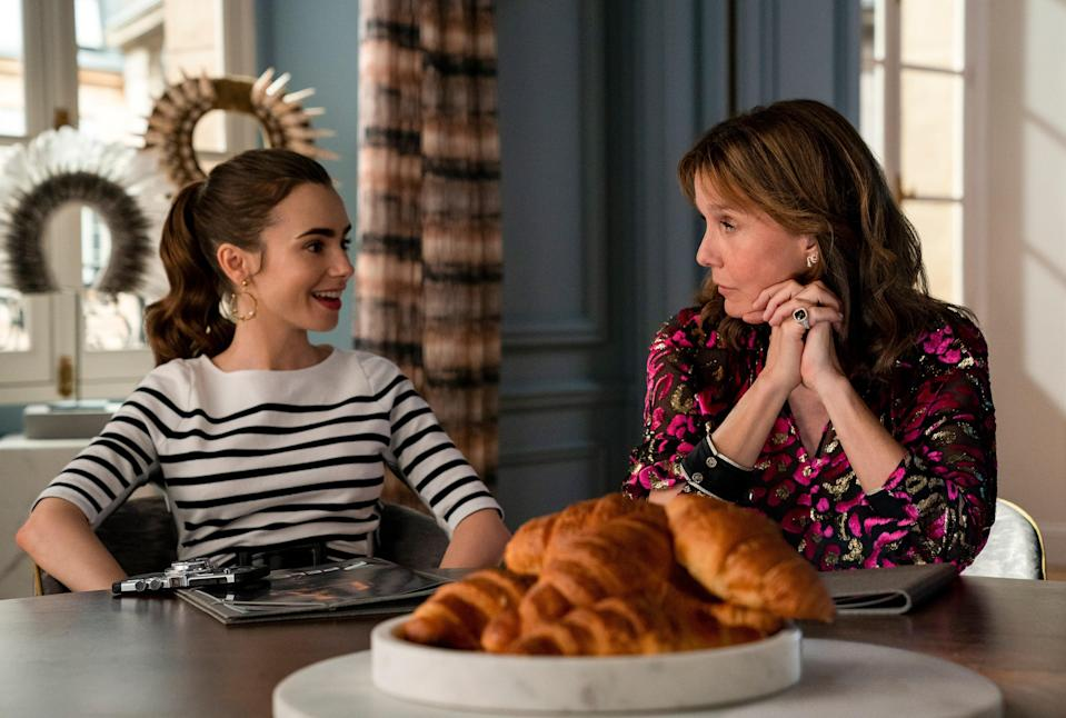 Collins as Emily, Leroy-Beaulieu as Sylvie, and lots of buttery croissants in episode 207