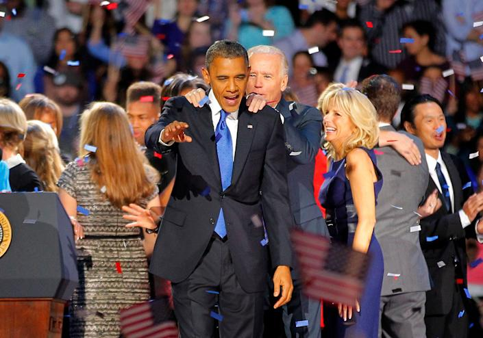 Vice President Joe Biden holds on to President Barack Obama after delivering his victory speech to supporters gathered in Chicago early Wednesday Nov. 7 2012. (AP Photo/Jerome Delay)