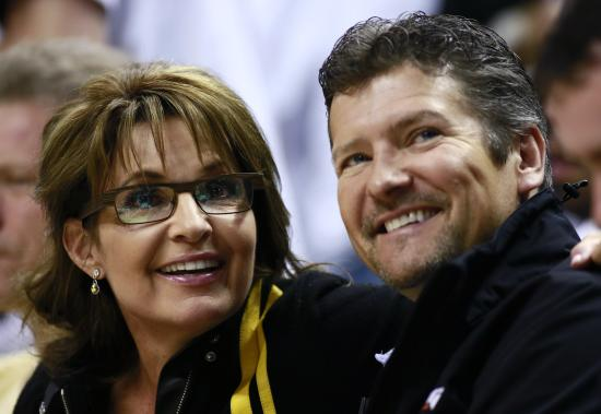 Sarah Palin and her husband, Todd, photographed at the NBA Eastern Conference final basketball playoff series in 2013. (Reuters/Brent Smith/File)